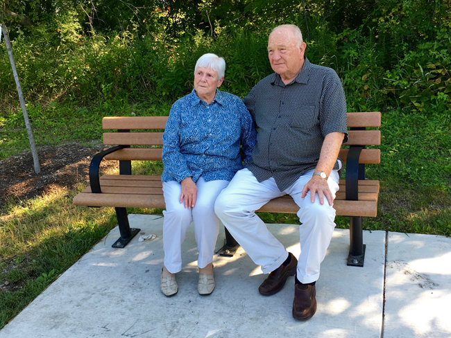 "Judy and Dan Printz, Mary Ellyn's sister and brother-in-law, sit on ""The Bench"""